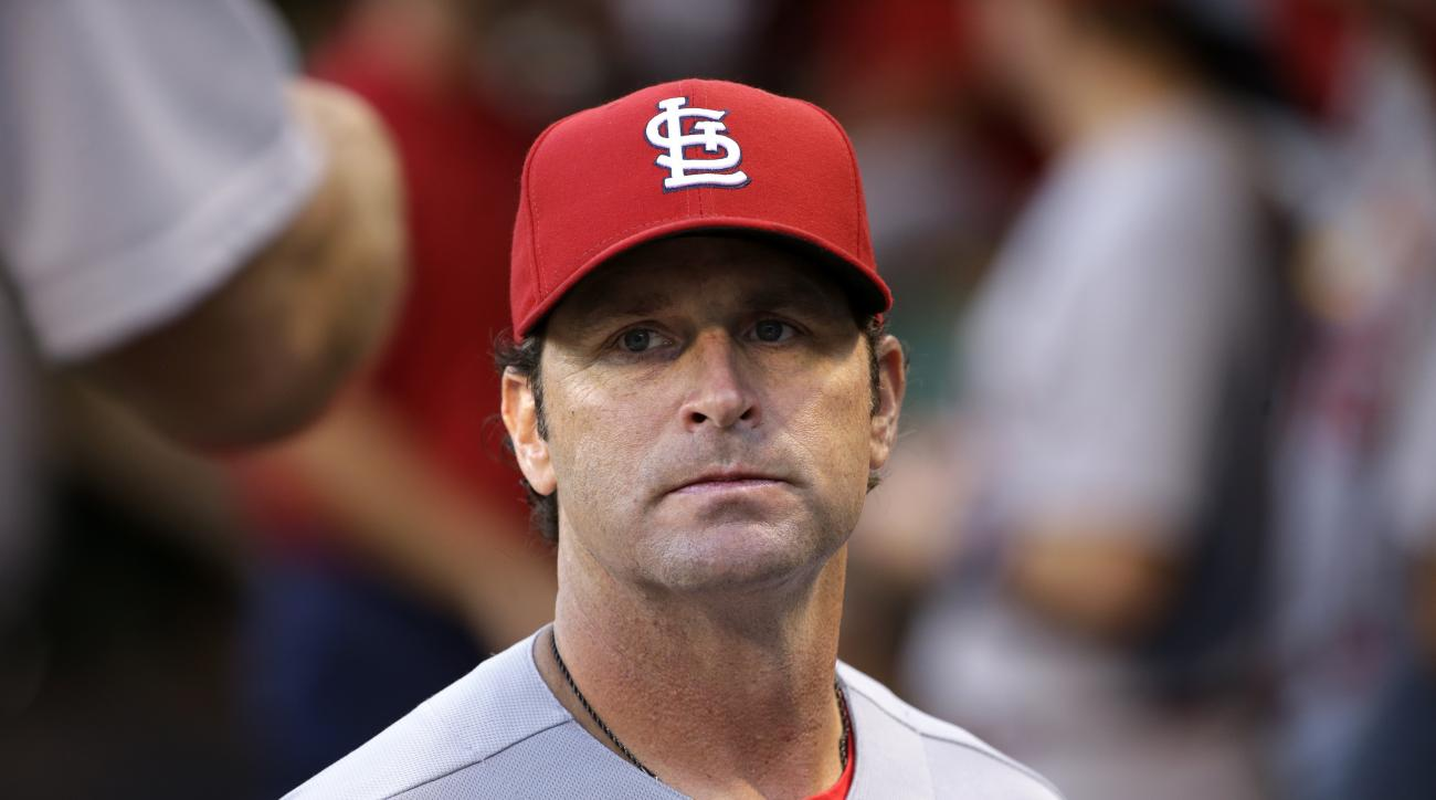 St. Louis Cardinals manager Mike Matheny stands in the dugout before a baseball game against the Pittsburgh Pirates in Pittsburgh, Wednesday, Sept. 7, 2016. (AP Photo/Gene J. Puskar)