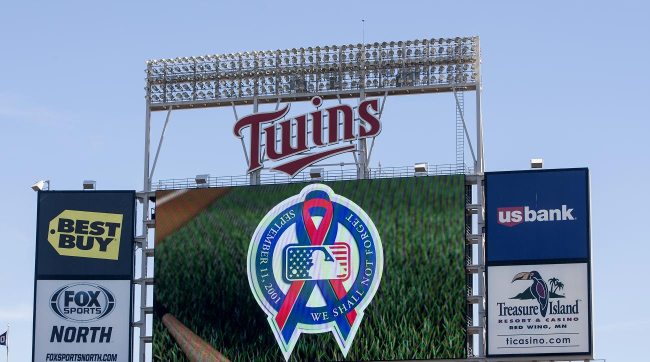 The scoreboard at Target Field displays a September 11th message before a baseball game between the Minnesota Twins and the Cleveland Indians, Sunday, Sept. 11, 2016, in Minneapolis. (AP Photo/Paul Battaglia)