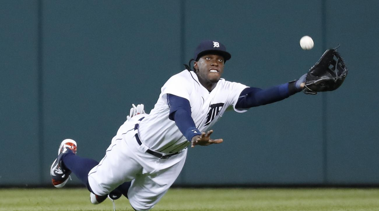 FILE - In this Sept. 13, 2016, file photo, Detroit Tigers center fielder Cameron Maybin dives to catch a fly ball by Minnesota Twins' Eduardo Escobar during a baseball game in Detroit. The Los Angeles Angels have acquired Maybin from the Tigers in a trade
