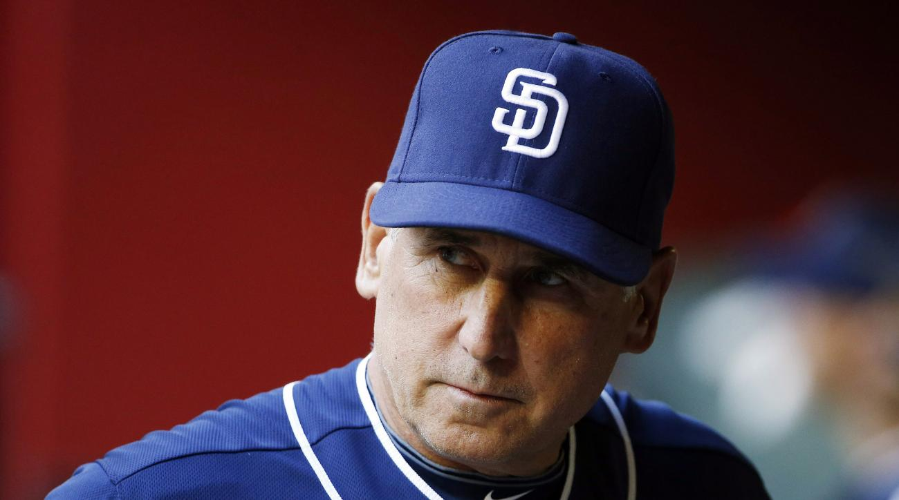 FILE - In this May 8, 2015, file photo, San Diego Padres' Bud Black paces in the dugout prior to a baseball game against the Arizona Diamondbacks in Phoenix. The Padres fired Black on Monday, June 15, 2015, after hovering around .500 with a roster that wa