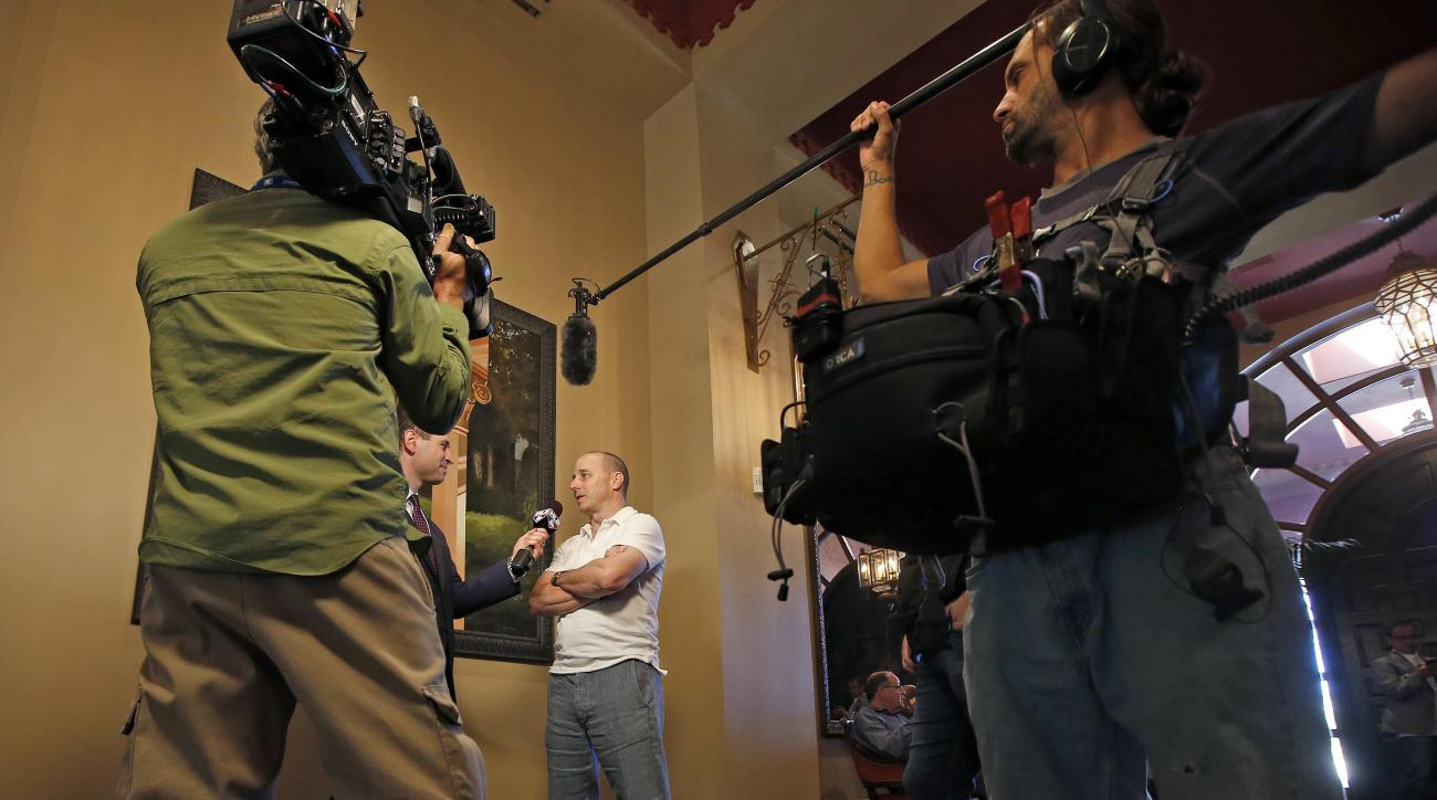 New York Yankees general manager Brian Cashman is interviewed during baseball's annual general managers meeting Wednesday, Nov. 9, 2016, in Scottsdale, Ariz. (AP Photo/Ross D. Franklin)