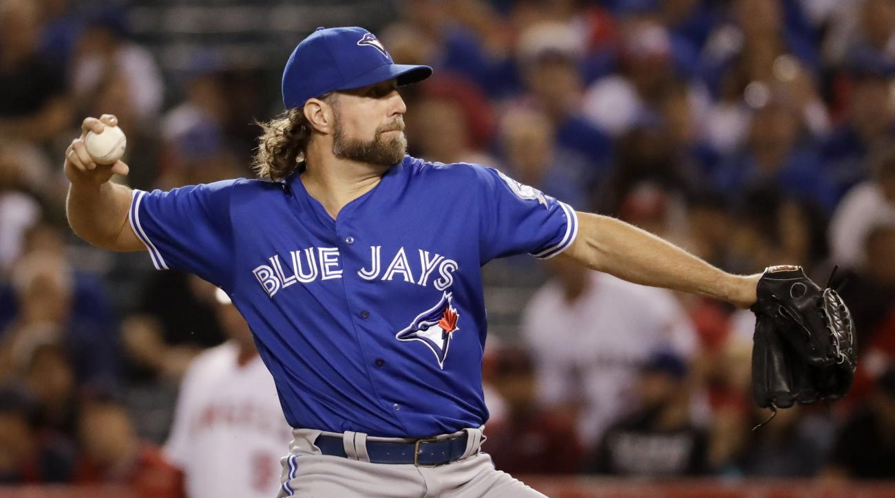 Toronto Blue Jays starting pitcher R.A. Dickey throws against the Los Angeles Angels during the first inning of a baseball game in Anaheim, Calif., Friday, Sept. 16, 2016. (AP Photo/Chris Carlson)