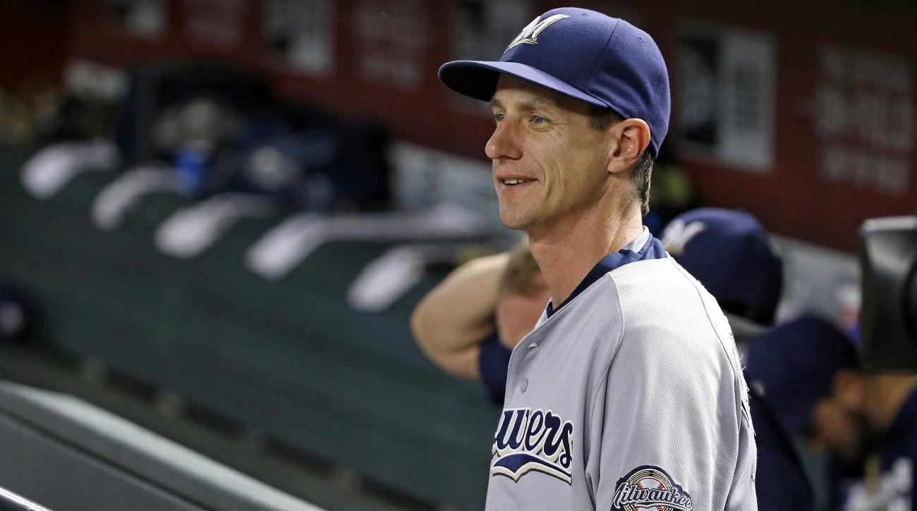 Milwaukee Brewers' Craig Counsell smiles as he sits in the dugout prior to a baseball game against the Arizona Diamondbacks Friday, Aug. 5, 2016, in Phoenix.  The Diamondbacks defeated the Brewers 3-2 in 11 innings. (AP Photo/Ross D. Franklin)
