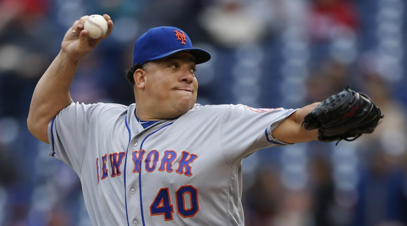 New York Mets starting pitcher Bartolo Colon throws in the first inning of a baseball game against the Philadelphia Phillies, Saturday, Oct. 1, 2016, in Philadelphia. (AP Photo/Laurence Kesterson)