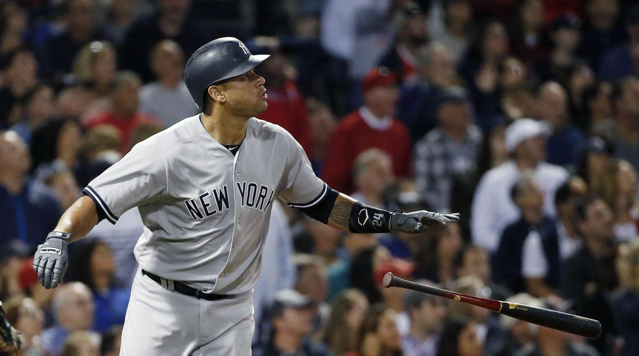 FILE - In this Sept. 16, 2016, file photo, New York Yankees' Gary Sanchez watches his two-run double against the Boston Red Sox during the fifth inning of a baseball game in Boston. Corey Seager of the Los Angeles Dodgers is the favorite in the NL, while