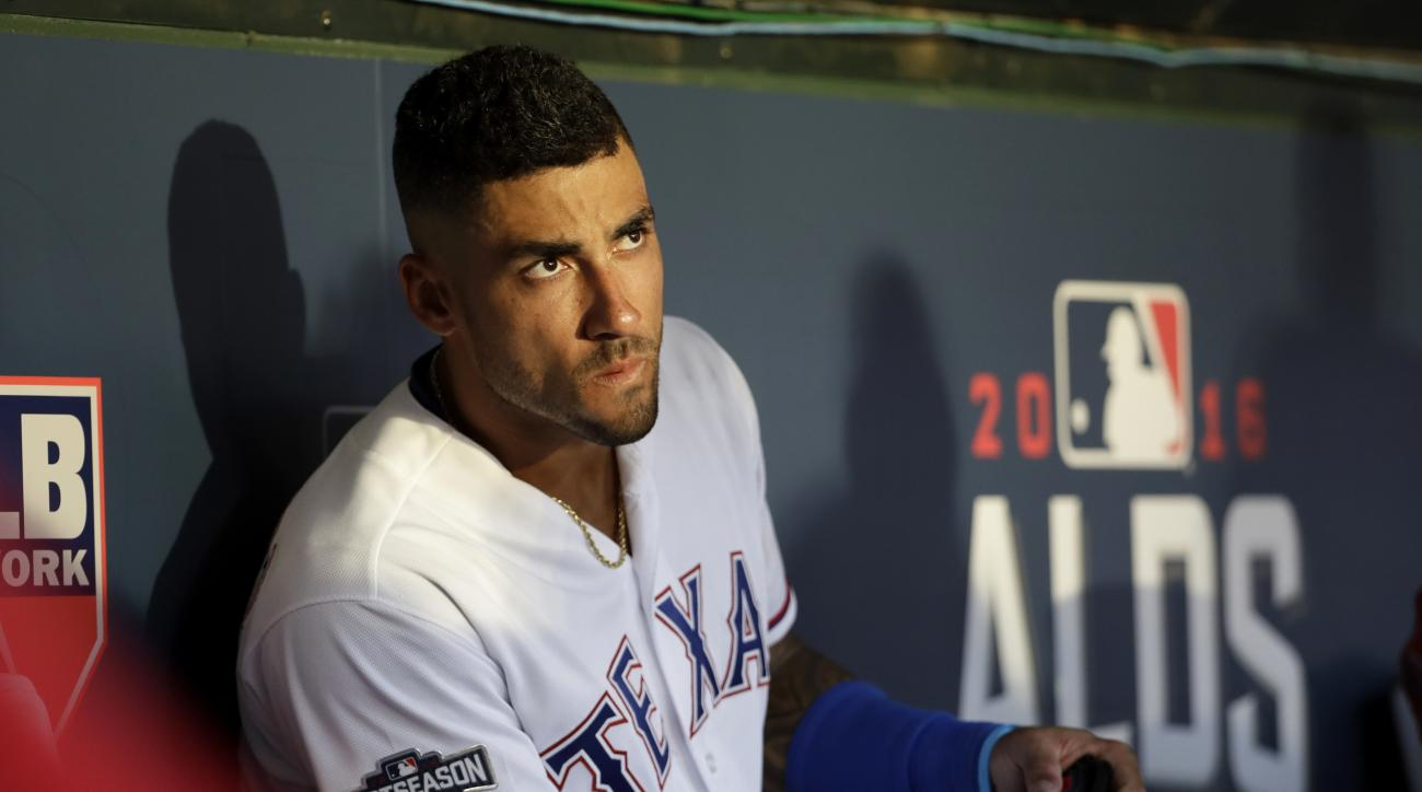 This Oct. 6, 2016 photo shows Texas Rangers center fielder Ian Desmond looking to the outfield in the ninth inning of Game 1 of the American League Division Series baseball game against Toronto Blue Jays in Arlington, Texas. Desmond has turned down a $17.