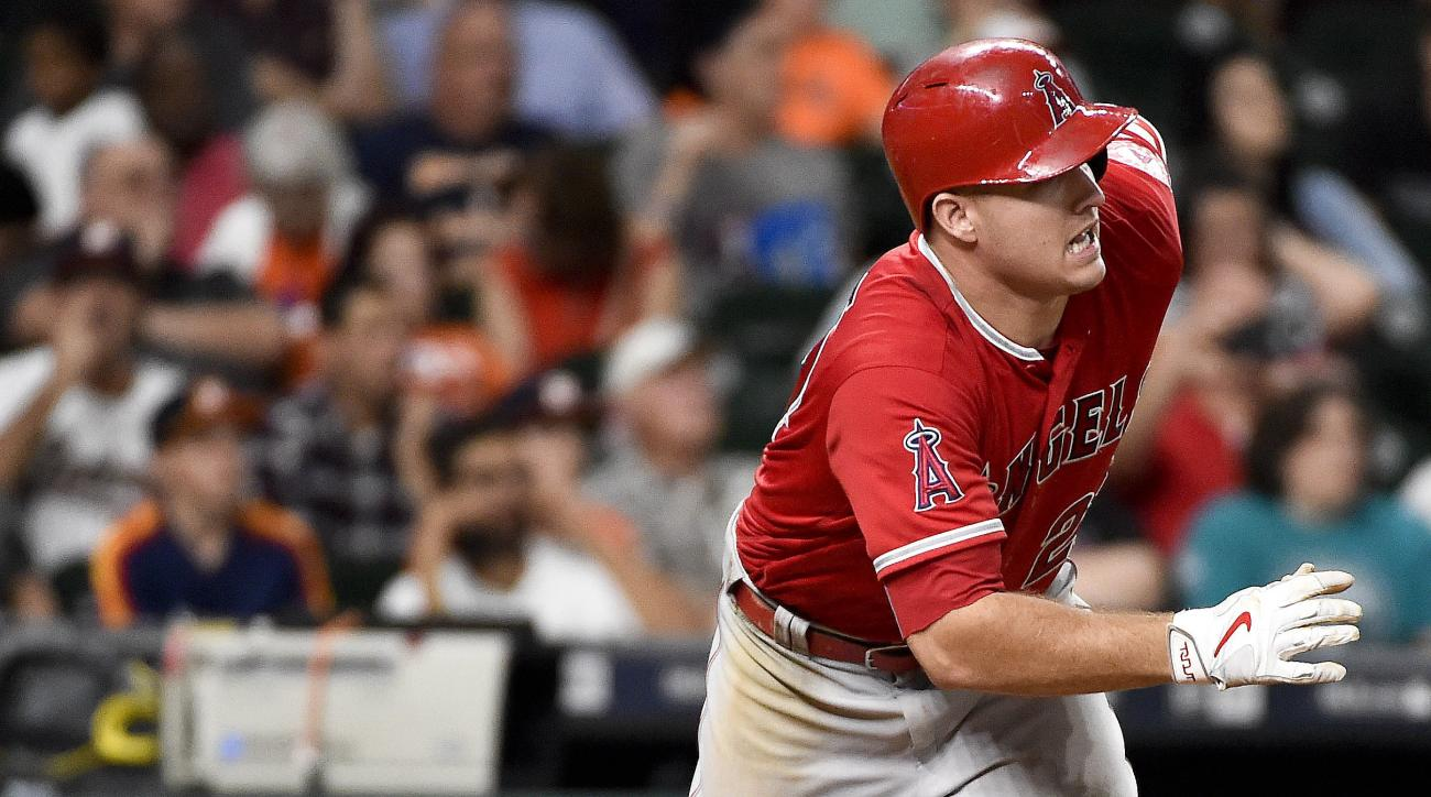FILE - In this Sept. 24, 2016, file photo, Los Angeles Angels' Mike Trout watches his RBI-single in the eighth inning of a baseball game against the Houston Astros, in Houston. Trout, Mookie Betts and Jose Altuve are the finalists for the American League