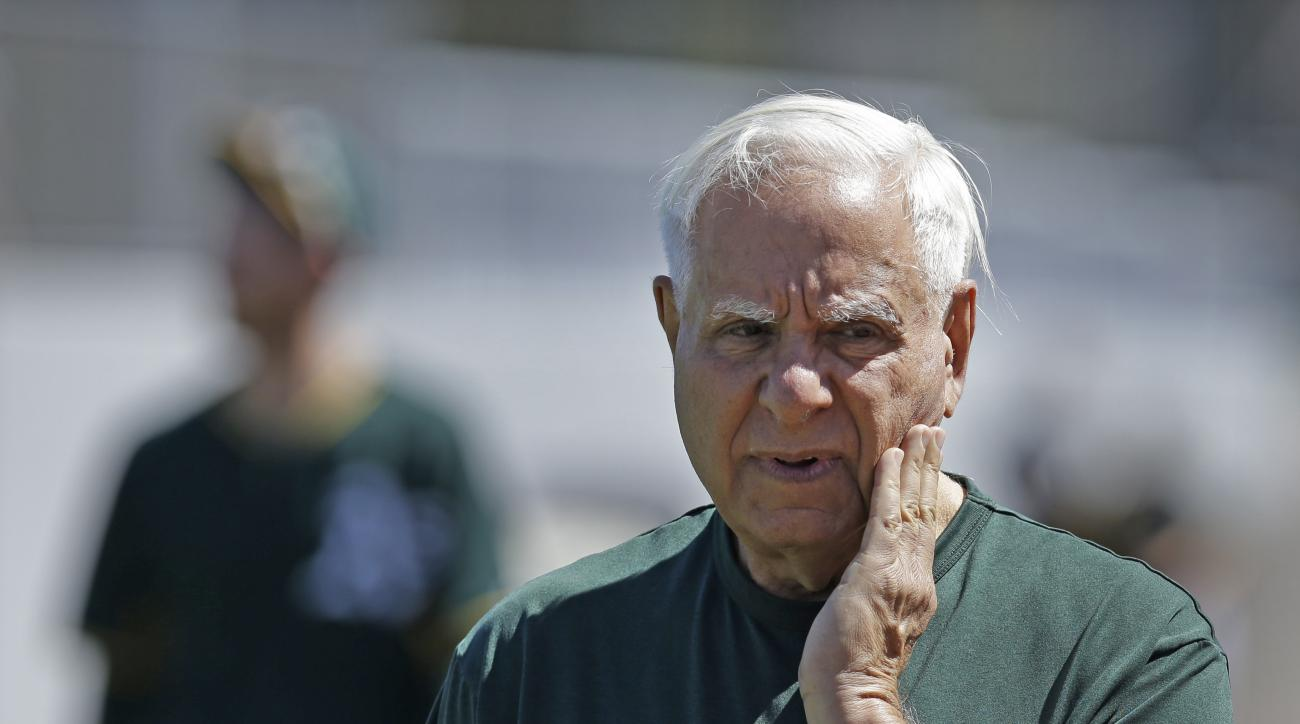 Oakland Athletics owner Lew Wolff watches players during batting practice prior to a spring training exhibition baseball game against the Texas Rangers Friday, March 27, 2015, in Mesa, Ariz. (AP Photo/Ben Margot)