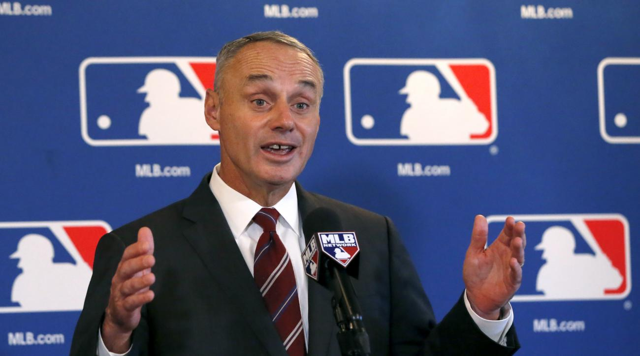 Baseball Commissioner Rob Manfred responds to a question after the baseball owners quarterly meetings at the Drake Hotel Thursday, Nov. 17, 2016, in Chicago. (AP Photo/Charles Rex Arbogast)