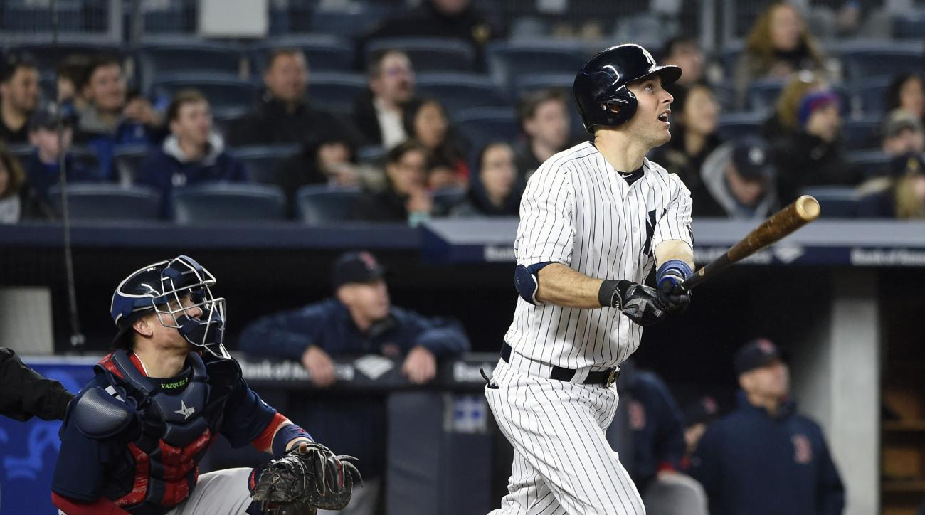 FILE - In this May 6, 2016, file photo, New York Yankees' Dustin Ackley watches his fly ball in a baseball game against the Boston Red Sox in New York. THe Yankees have released utilityman Ackley and announced that injured pitcher Nathan Eovaldi has been