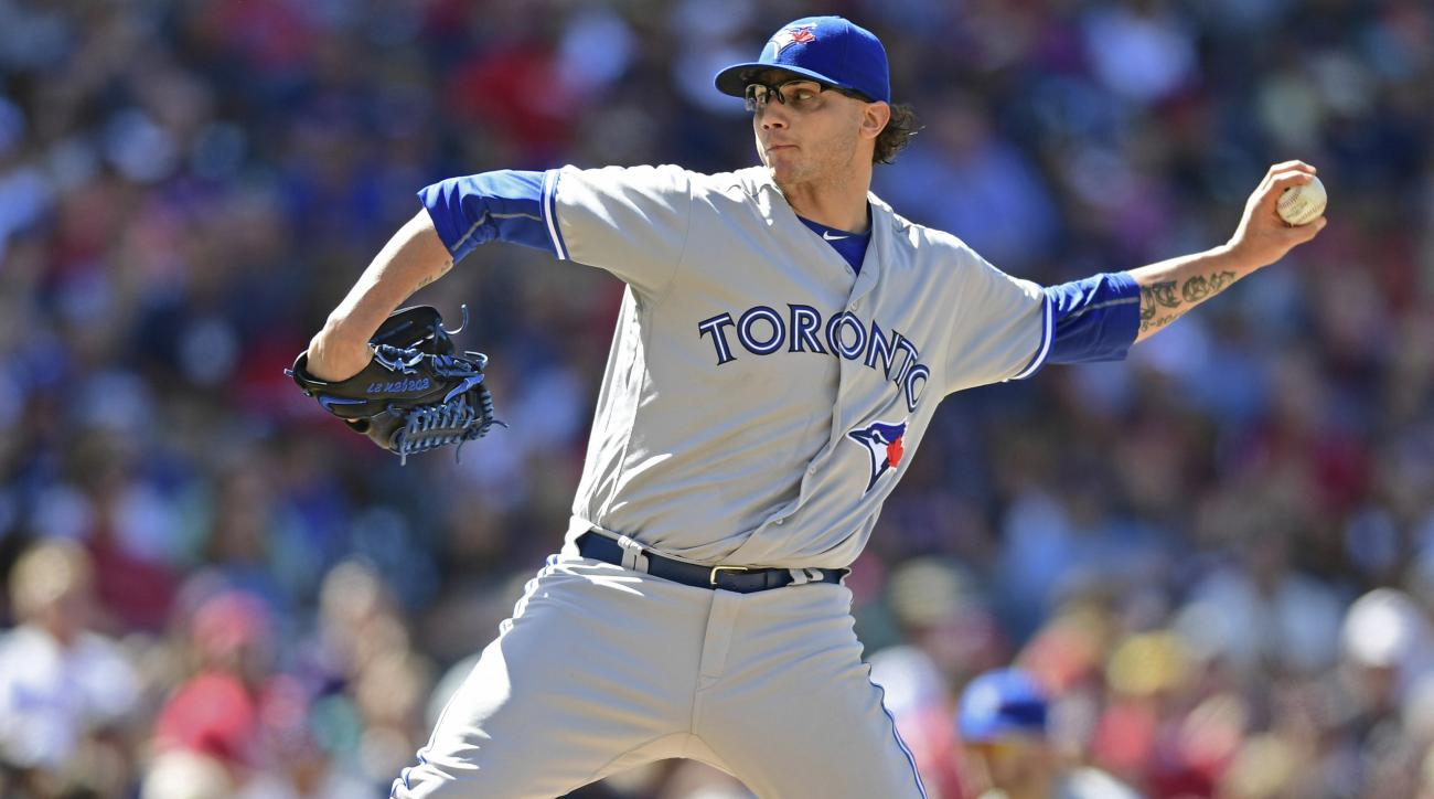 FILE - In this Aug. 21, 2016, file photo, Toronto Blue Jays relief pitcher Brett Cecil delivers in the eighth inning of a baseball game against the Cleveland Indians, in Cleveland. The Cardinals signed reliever Brett Cecil to a four-year, $30.5 million co