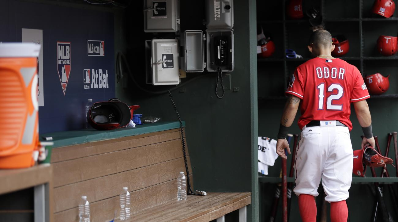 Texas Rangers' Rougned Odor walks out of the dugout after a 5-3 loss to the Toronto Blue Jays in Game 2 of baseball's American League Division Series, Friday, Oct. 7, 2016, in Arlington, Texas. The Blue Jays lead the series 2-0. (AP Photo/David J. Phillip