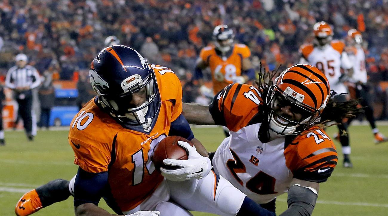 Denver Broncos wide receiver Emmanuel Sanders (10) scores a touchdown as Cincinnati Bengals cornerback Adam Jones (24) defends during the first half of an NFL football game, Monday, Dec. 28, 2015, in Denver. (AP Photo/Jack Dempsey)
