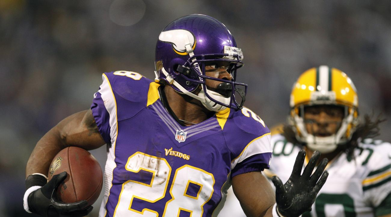 FILE - In this Dec. 30, 2012, file photo, Minnesota Vikings running back Adrian Peterson, left, runs from Green Bay Packers cornerback Tramon Williams during the first half of an NFL football game in Minneapolis. This weekend won't be the first time a Gre