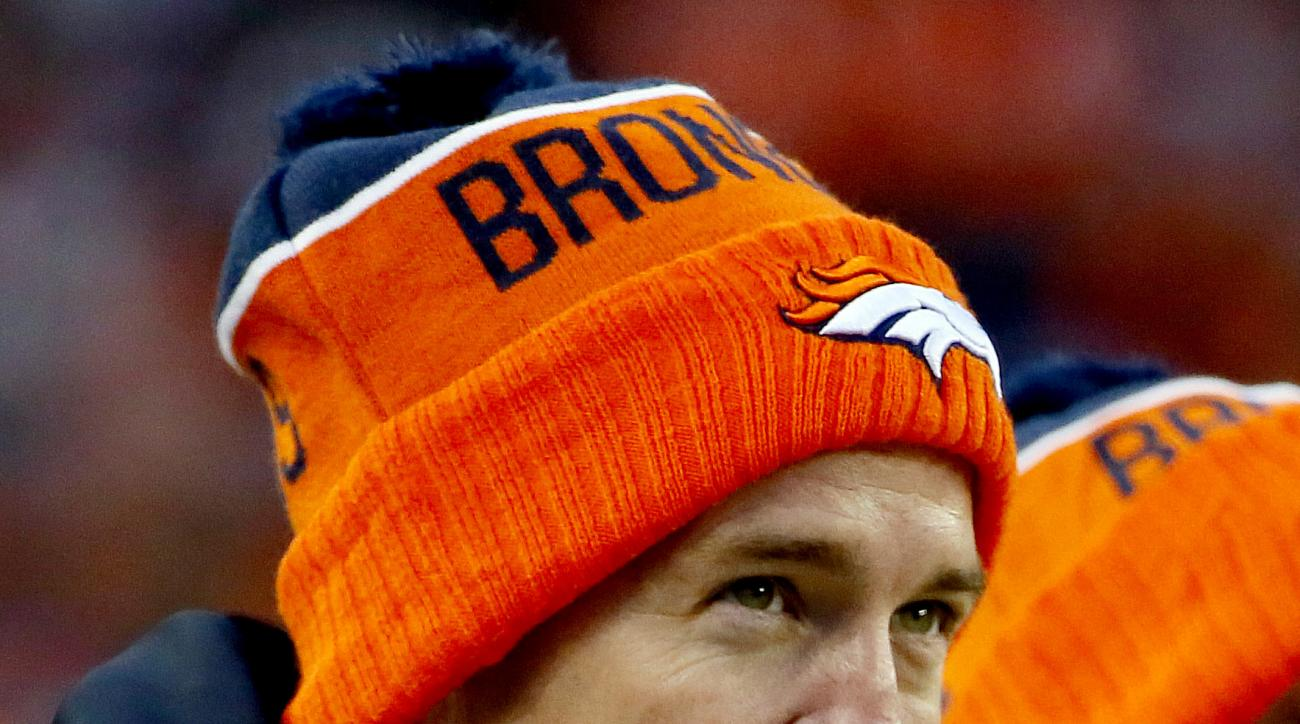 FILE - In this Dec. 13, 2015, file photo, Denver Broncos injured quarterback Peyton Manning watches from the sideline during the second half of an NFL football game against the Oakland Raiders in Denver. Manning may have been sidelined for the last half o