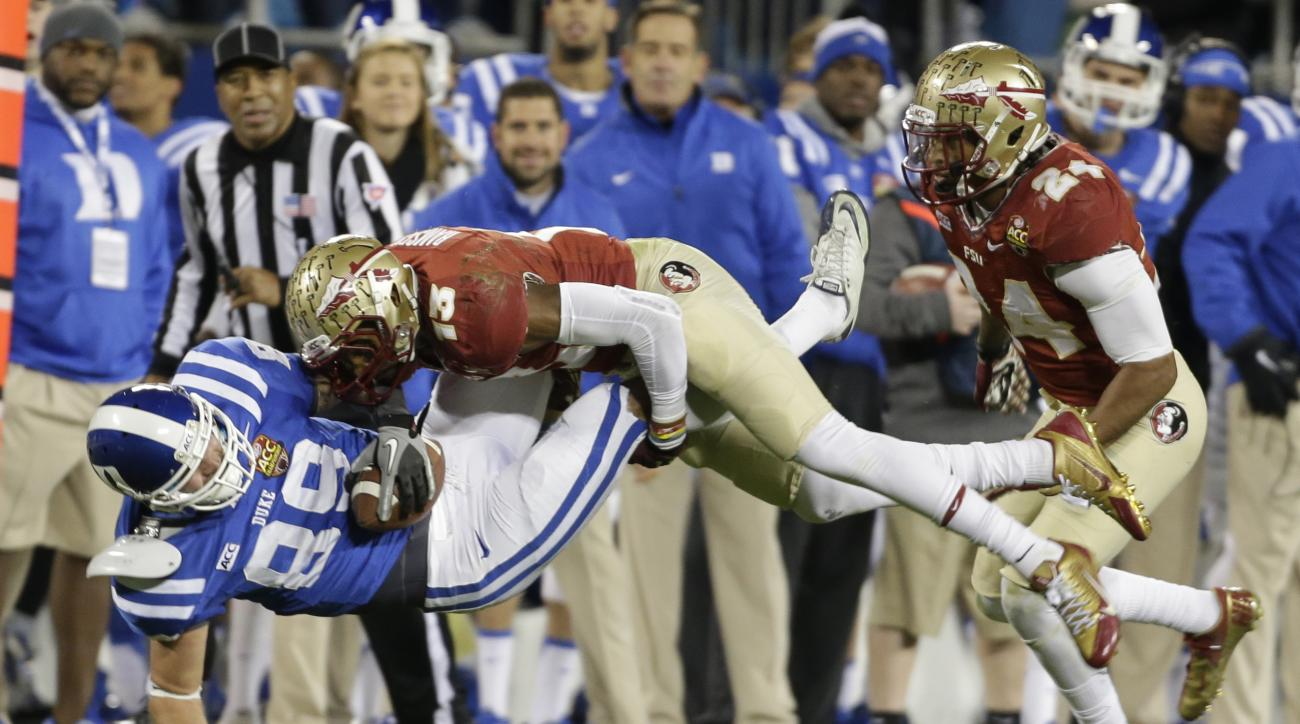 FILE - In this Saturday, Dec. 7, 2013, file photo, Duke's Braxton Deaver (89) is hit by Florida State's Jalen Ramsey (13) in the first half of the Atlantic Coast Conference Championship NCAA football game in Charlotte, N.C. Either the Tennessee Titans or