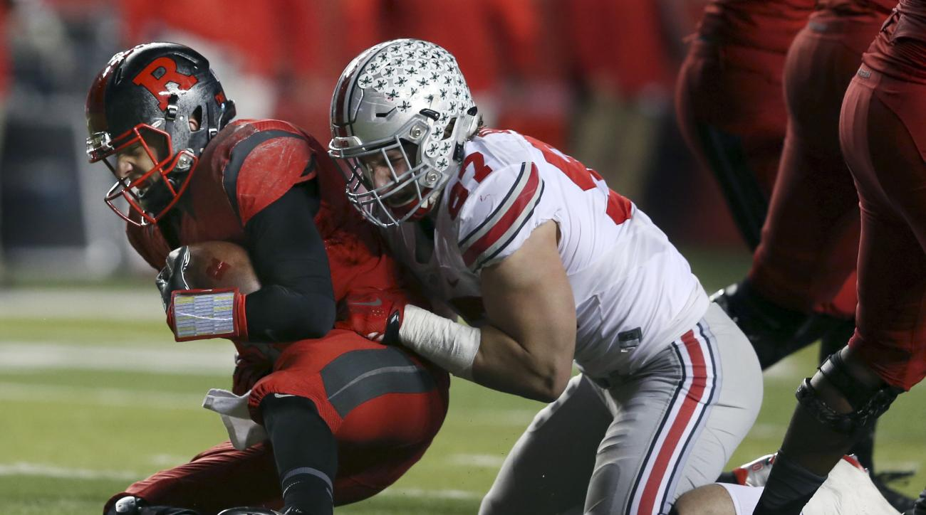 FILE - In this Saturday, Oct. 24, 2015, file photo, Ohio State defensive end Joey Bosa (97) sacks Rutgers quarterback Chris Laviano (5) during the first half of an NCAA college football game in Piscataway, N.J. Either the Tennessee Titans or Cleveland Bro