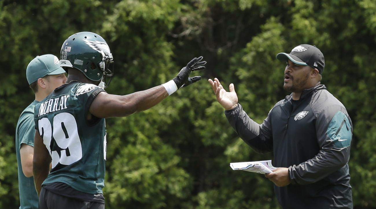 Philadelphia Eagles running backs coach Duce Staley, right, talks with DeMarco Murray during organized team activities at the NFL football team's practice facility, Monday, June 8, 2015, in Philadelphia. (AP Photo/Matt Slocum)