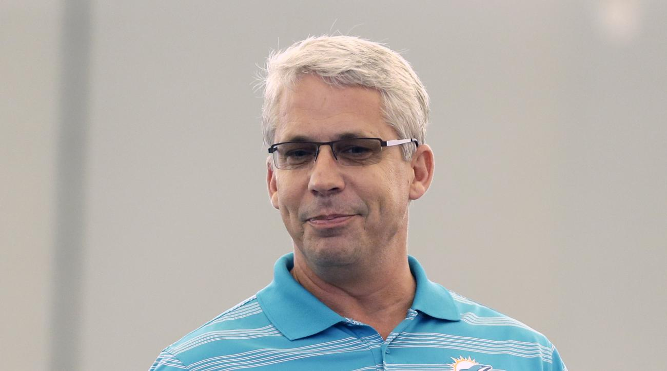 Miami Dolphins general manager Dennis Hickey walks on the field during a several fitness-orientated Hometown Huddle event at the Miami Dolphins football training camp, Tuesday, Oct. 20, 2015, in Davie, Fla. (AP Photo/Alan Diaz)