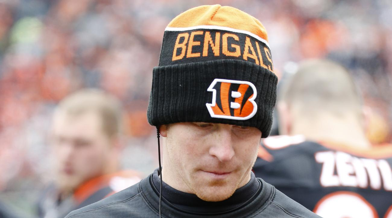 Cincinnati Bengals quarterback Andy Dalton walks the sideline in the first half of an NFL football game against the Baltimore Ravens, Sunday, Jan. 3, 2016, in Cincinnati. (AP Photo/Frank Victores)