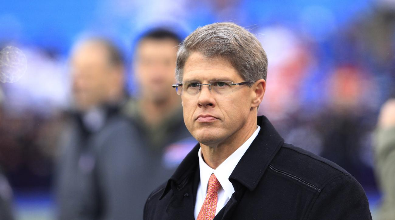 Kansas City Chiefs owner Clark Hunt walks on the field prior to an NFL football game against the Buffalo Bills, Sunday, Nov. 9, 2014, in Orchard Park, N.Y. (AP Photo/Bill Wippert)