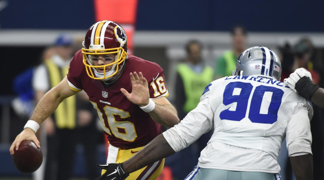 Washington Redskins quarterback Colt McCoy (16) scrambles out of the pocket under pressure from Dallas Cowboys defensive end Demarcus Lawrence (90) in the first half of an NFL football game, Sunday, Jan. 3, 2016, in Arlington, Texas. (AP Photo/Michael Ain