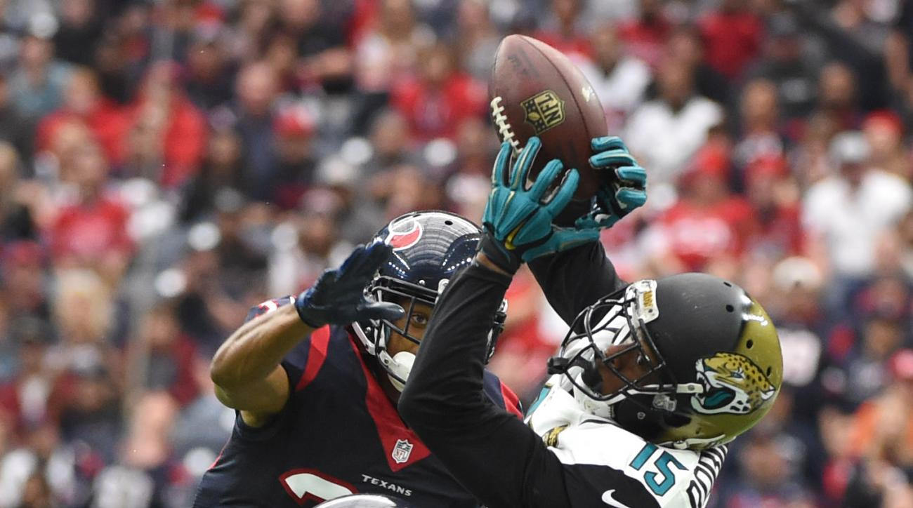 Houston Texans strong safety Quintin Demps (27) and strong safety Kevin Johnson (30) break up a pass intended for Jacksonville Jaguars wide receiver Allen Robinson (15) during the first half of an NFL football game Sunday, Jan. 3, 2016, in Houston. (AP Ph