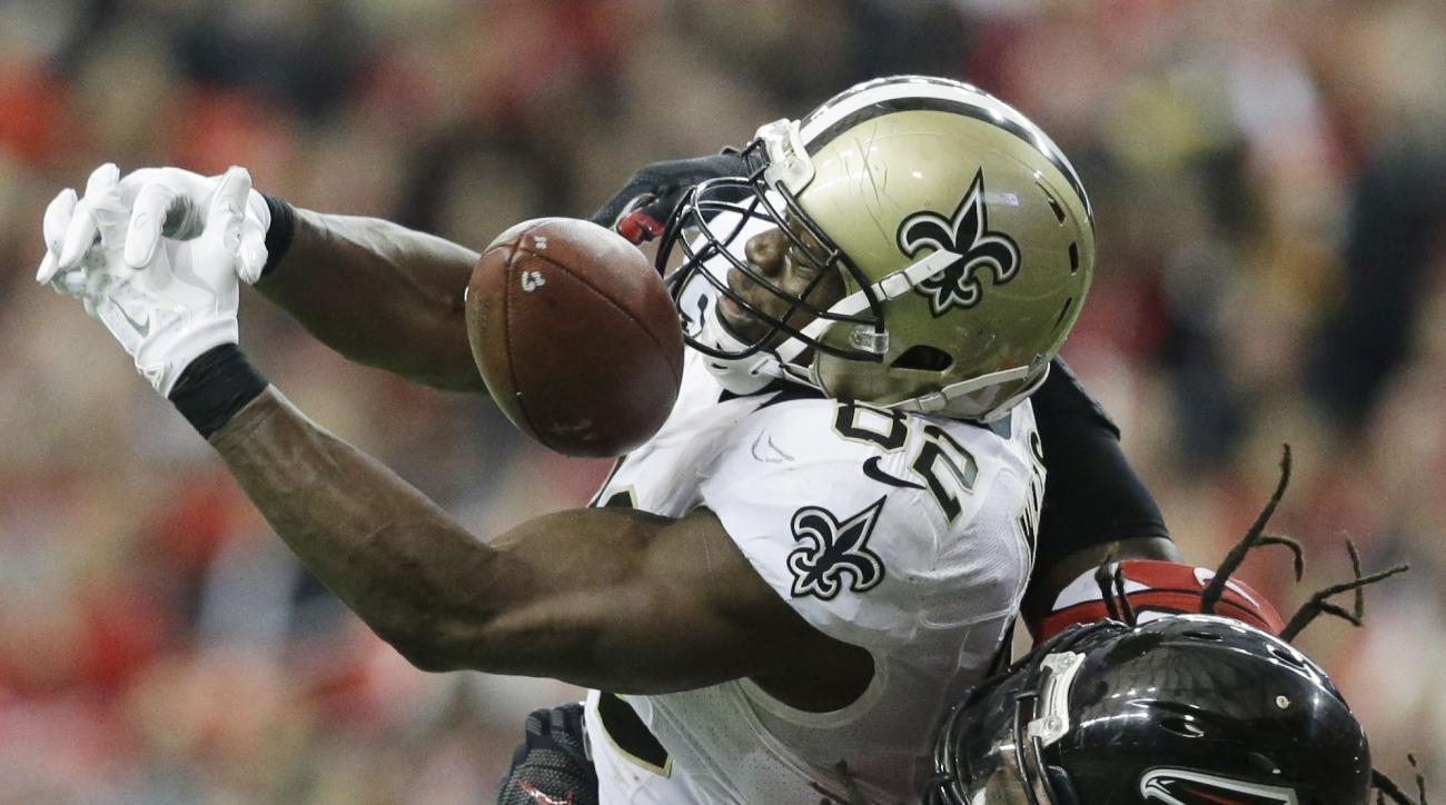 New Orleans Saints tight end Benjamin Watson (82) misses the catch against Atlanta Falcons strong safety Kemal Ishmael (36) during the second half of an NFL football game, Sunday, Jan. 3, 2016, in Atlanta. (AP Photo/David Goldman)
