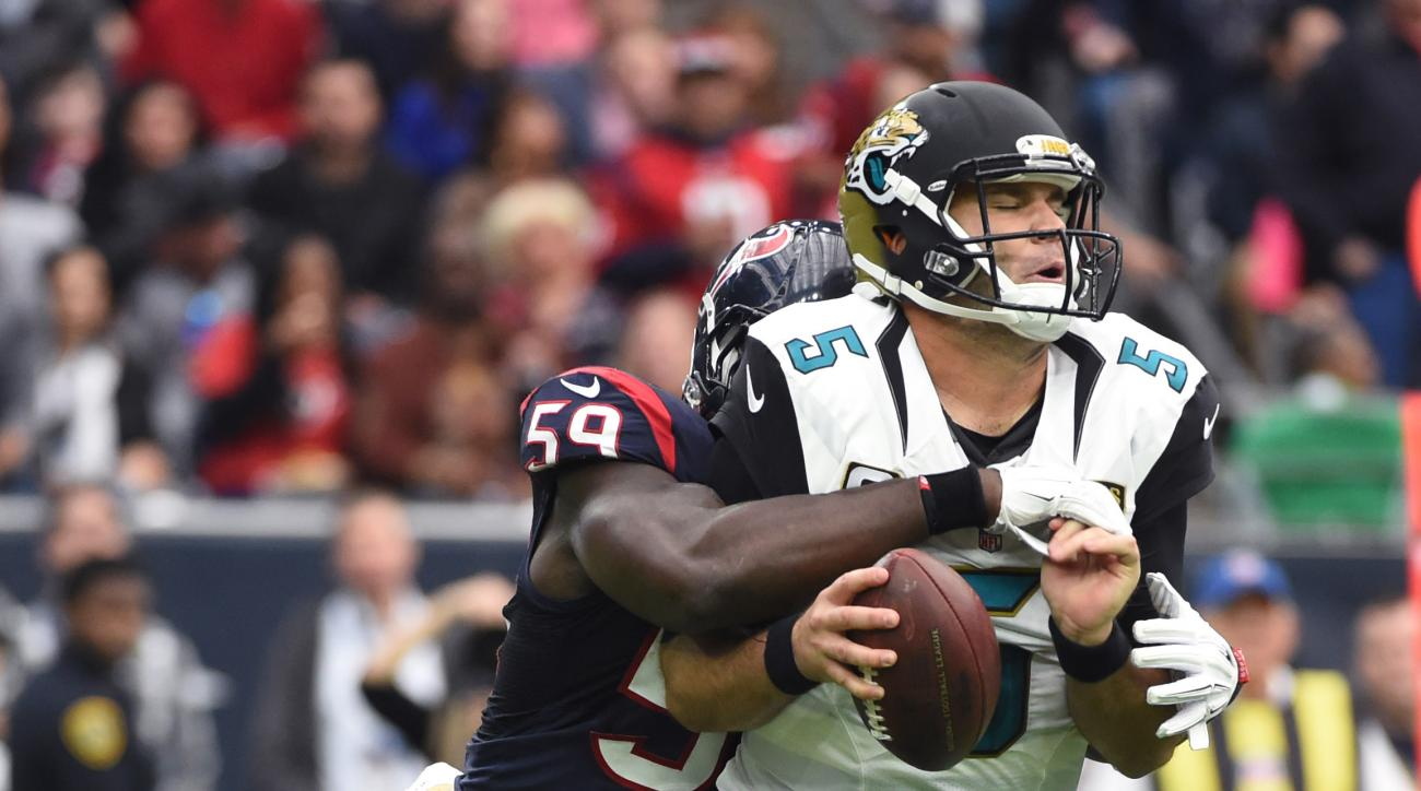 Jacksonville Jaguars quarterback Blake Bortles (5) is sacked by Houston Texans outside linebacker Whitney Mercilus (59) during the first half of an NFL football game Sunday, Jan. 3, 2016, in Houston. (AP Photo/Eric Christian Smith)