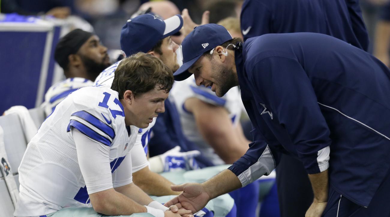 Dallas Cowboys quarterback Kellen Moore, left, talks with injured quarterback Tony Romo, right, in the second half of an NFL football game against the Washington Redskins on Sunday, Jan. 3, 2016, in Arlington, Texas. (AP Photo/Tim Sharp)