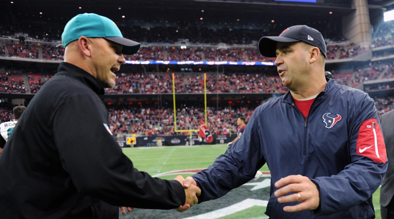 Jacksonville Jaguars head coach Gus Bradley, left, and Houston Texans head coach Bill O'Brien greet at midfield following an NFL football game Sunday, Jan. 3, 2016, in Houston. (AP Photo/Eric Christian Smith)