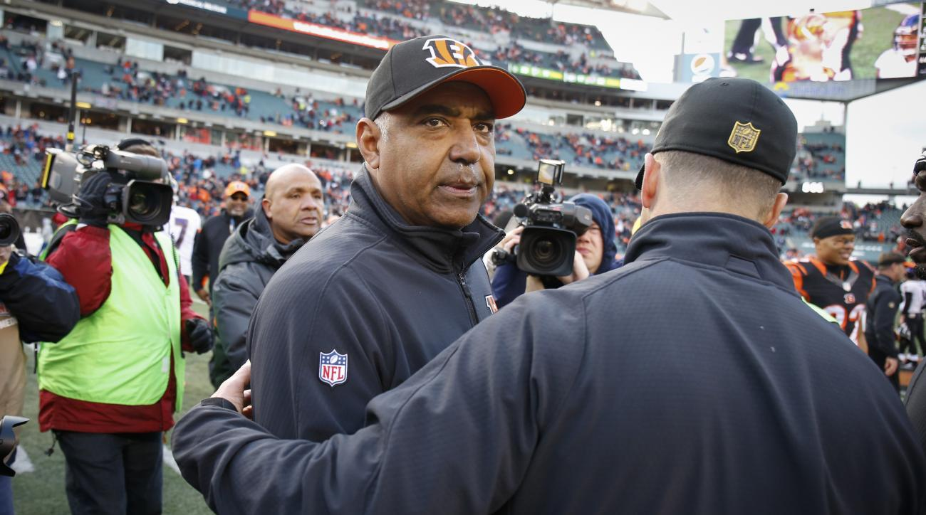 Cincinnati Bengals head coach Marvin Lewis meets with Baltimore Ravens head coach John Harbaugh, right, after an NFL football game, Sunday, Jan. 3, 2016, in Cincinnati. Cincinnati won 24-16. (AP Photo/Gary Landers)