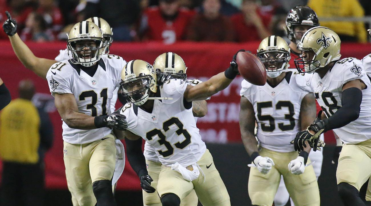 New Orleans Saints safety (33) Jamarca Sanford and teammates celebrate after he intercepted a pass thrown by Atlanta Falcons quarterback Matt Ryan during an NFL football game, Sunday, Jan. 3, 2016, in Atlanta. The turnover led to a Saints field goal to wi