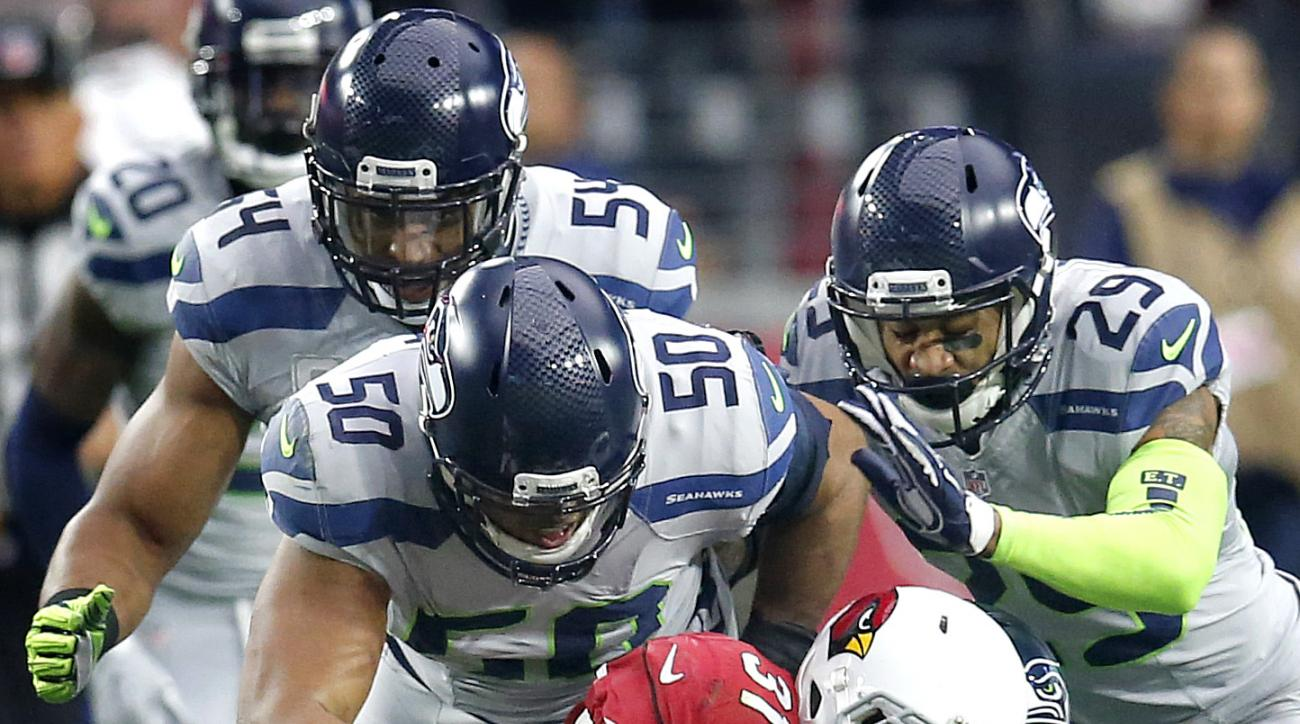 Arizona Cardinals running back David Johnson (31) is stopped by Seattle Seahawks outside linebacker K.J. Wright (50), free safety Earl Thomas (29), defensive tackle Ahtyba Rubin (77), defensive tackle Brandon Mebane (92) and  middle linebacker Bobby Wagne