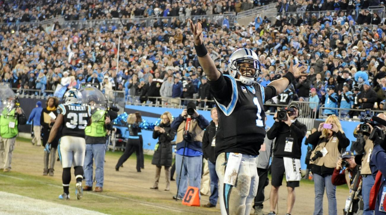 Carolina Panthers quarterback Cam Newton (1) celebrates a touchdown pass against the Tampa Bay Buccaneers in the second half of an NFL football game in Charlotte, N.C., Sunday, Jan. 3, 2016. (AP Photo/Mike McCarn)