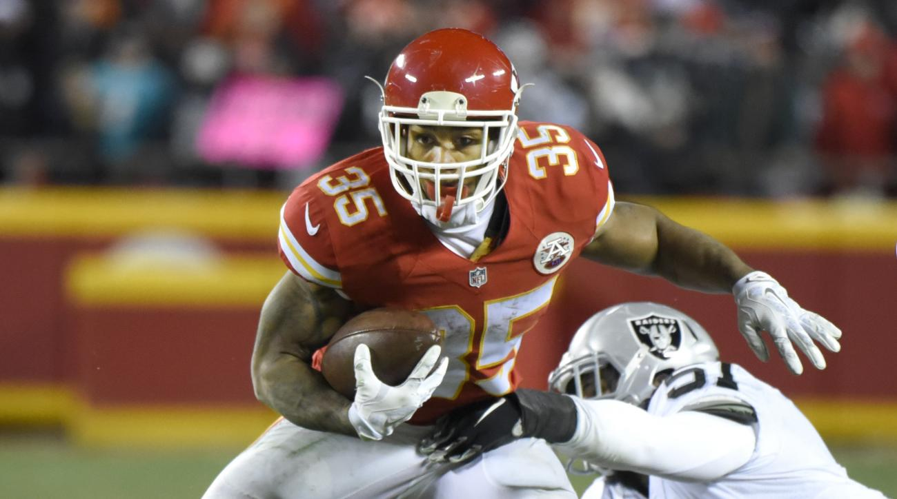 Kansas City Chiefs running back Charcandrick West (35) breaks a tackle by Oakland Raiders linebacker Ben Heeney (51) during the second half of an NFL football game in Kansas City, Mo., Sunday, Jan. 3, 2016. (AP Photo/Ed Zurga)