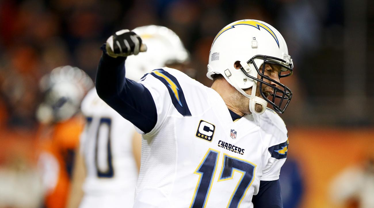 San Diego Chargers quarterback Philip Rivers celebrates after wide receiver Tyrell Williams scored during the second half in an NFL football game against the Denver Broncos, Sunday, Jan. 3, 2016, in Denver. (AP Photo/David Zalubowski)