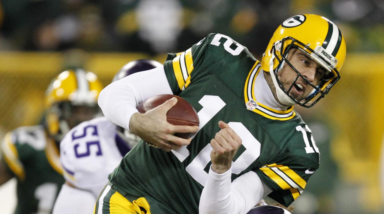 Green Bay Packers' Aaron Rodgers (12) is stopped by Minnesota Vikings' Eric Kendricks (54) on a third down run during the first half an NFL football game Sunday, Jan. 3, 2016, in Green Bay, Wis. (AP Photo/Matt Ludtke)