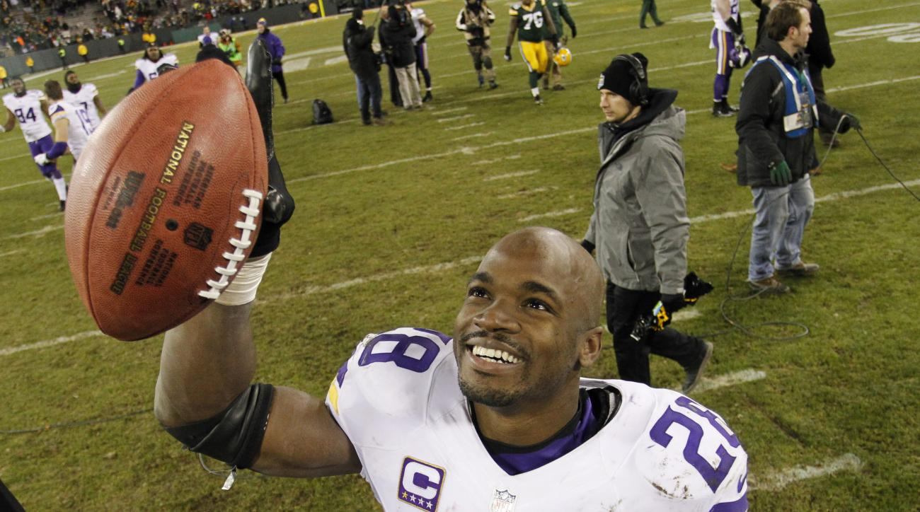Minnesota Vikings' Adrian Peterson celebrates after an NFL football game against the Green Bay Packers Sunday, Jan. 3, 2016, in Green Bay, Wis. The Vikings won 20-13. (AP Photo/Matt Ludtke)