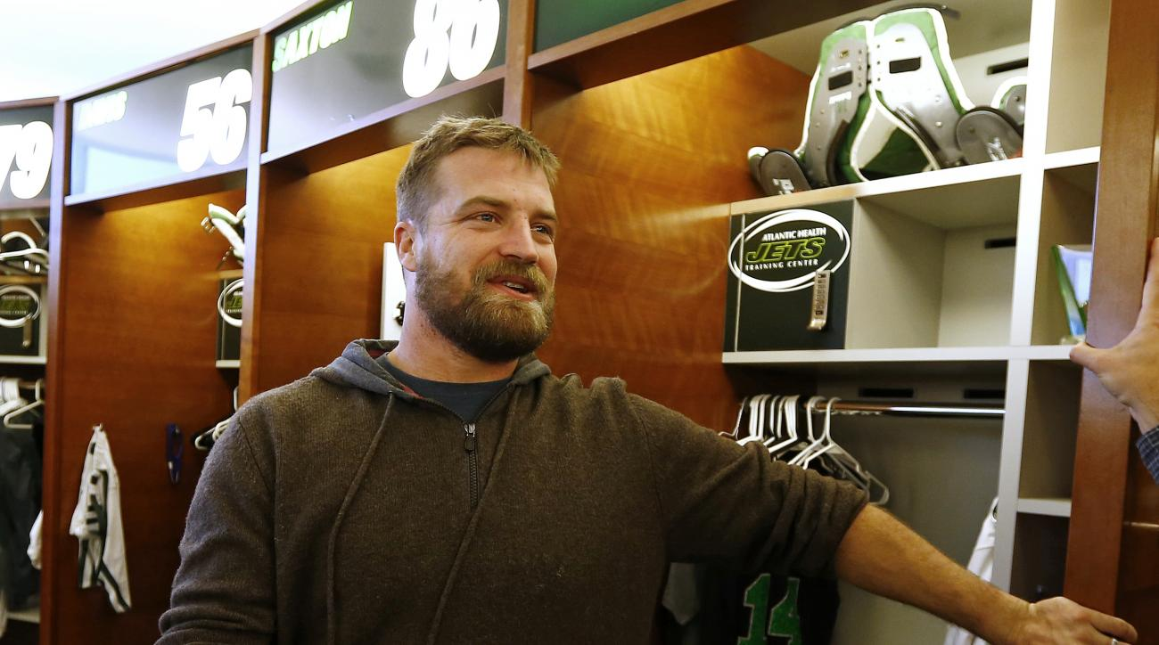 New York Jets quarterback Ryan Fitzpatrick talks to the media as the team clears out their lockers at the team's NFL football training facility, Monday, Jan. 4, 2016, in Florham Park, N.J. (AP Photo/Rich Schultz)