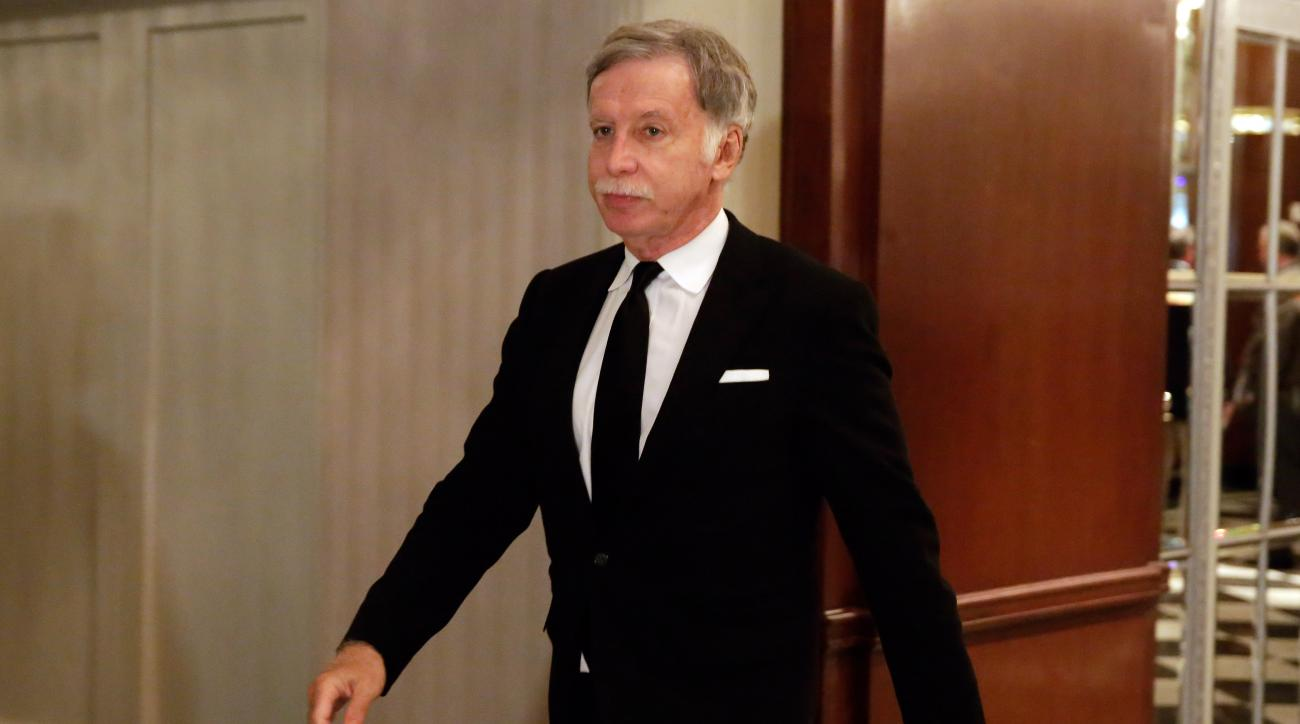 FILE - In this Oct. 7, 2015, file photo, St. Louis Rams owner Stan Kroenke walks in the hallway during a break of National Football League owners meeting, in New York. Monday, Jan. 4, 2016, is the first day for teams to apply for relocation and St. Louis