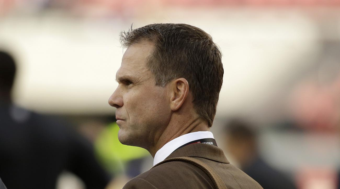 San Francisco 49ers general manager Trent Baalke watches as players warm up before an NFL football game between the San Francisco 49ers and the Minnesota Vikings in Santa Clara, Calif., Monday, Sept. 14, 2015. (AP Photo/Eric Risberg)