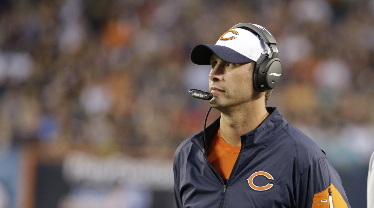 FILE - In this Aug. 13, 2015, file photo, Chicago Bears offensive coordinator Adam Gase during the first half of an NFL preseason football game against the Miami Dolphins in Chicago. Chip Kelly, Gase and Mike Shanahan are just a few of the hot names for t