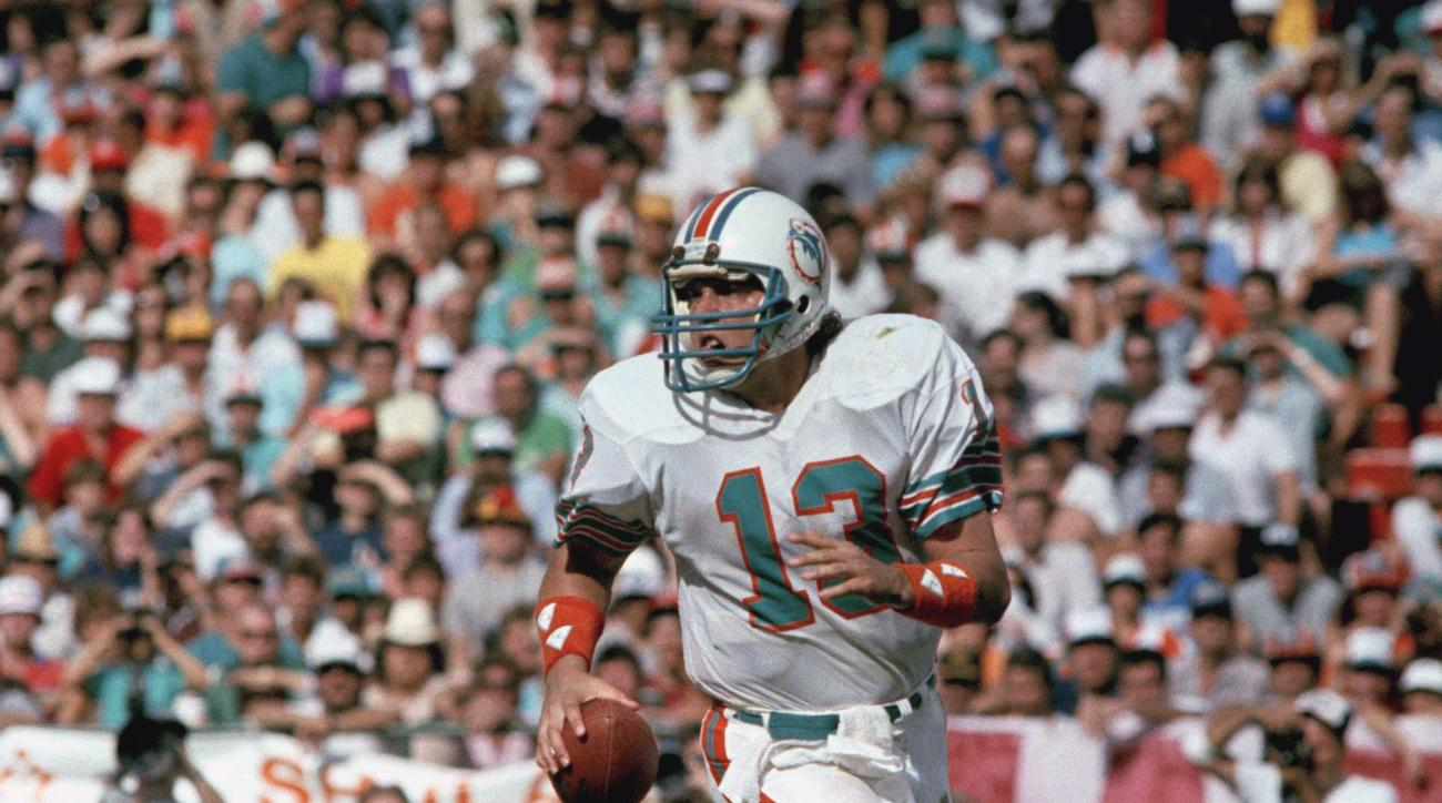 FILE - In this Jan. 20, 1985, file photo, Miami Dolphins quarterback Dan Marino scrambles during NFL football's Super Bowl XIX, against the San Francisco 49ers in Palo Alto, Calif. The San Francisco defense sacked the record-setting Marino four times in t