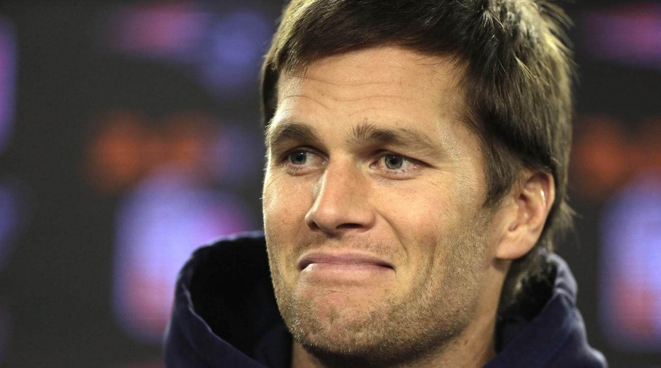 New England Patriots quarterback Tom Brady smiles while facing reporters before a scheduled NFL football practice, Wednesday, Jan. 6, 2016, in Foxborough, Mass. The Patriots are to host an NFL divisional playoff game Jan. 16, 2016,  in Foxborough, Mass.