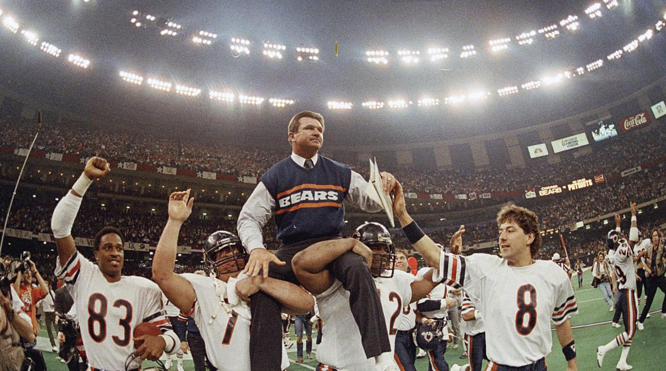 FILE - In this Jan. 26, 1986, file photo, Chicago Bears coach Mike Ditka is carried off the field by Steve McMichael, left, and William Perry after the Bears defeated the New England Patriots 46-10 in NFL football's Super Bowl XX in New Orleans. Willie Ga