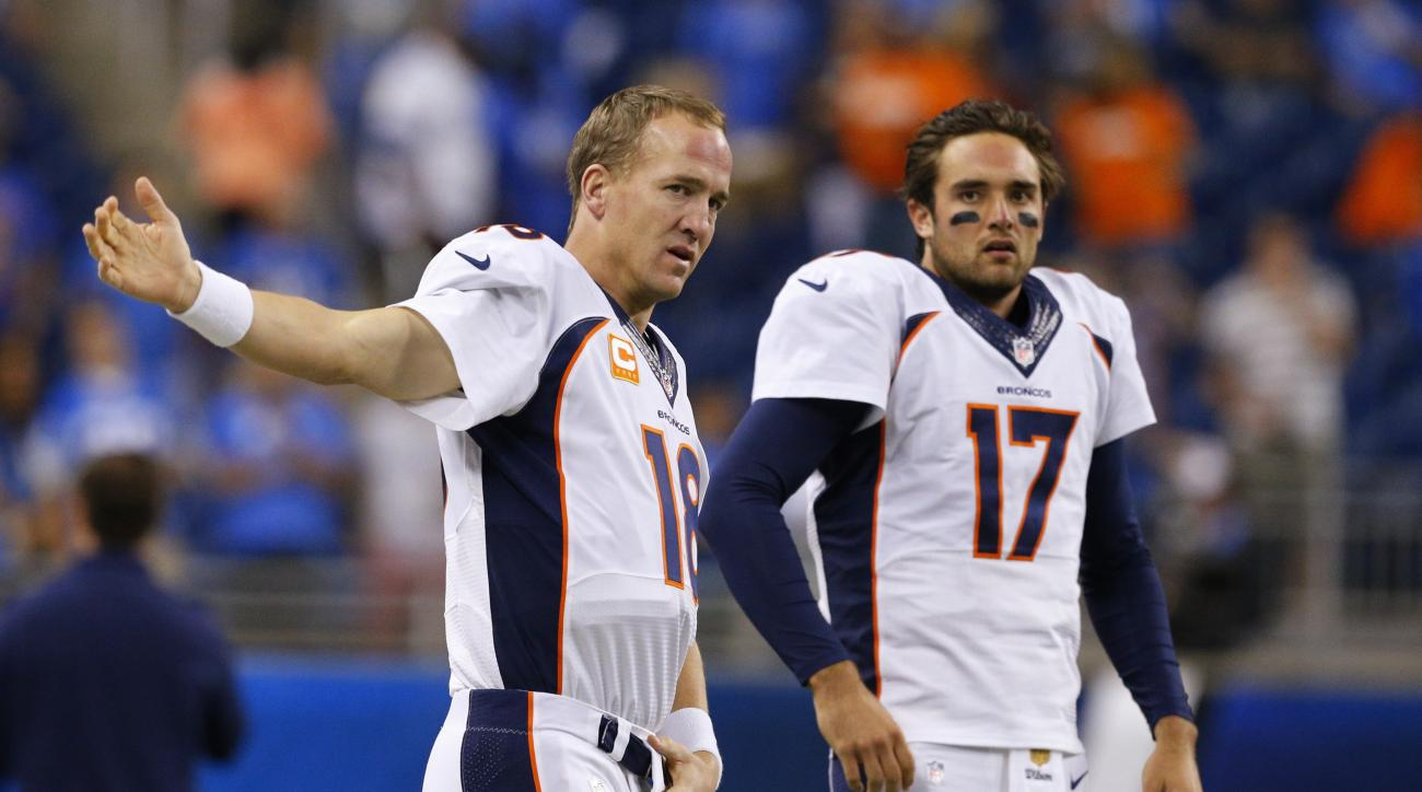 FILE - In this Sept. 27, 2015, file photo, Denver Broncos quarterbacks Peyton Manning (18) and Brock Osweiler (17) get ready for the Broncos' NFL football game against the Detroit Lions in Detroit. Who will start for the Broncos in the Jan. 17 divisional