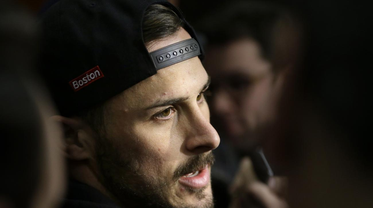 New England Patriots wide receiver Danny Amendola speaks with reporters in the team's locker room at Gillette Stadium after a football practice, Wednesday, Jan. 6, 2016, in Foxborough, Mass. The Patriots are to host an NFL divisional playoff game Jan. 16,