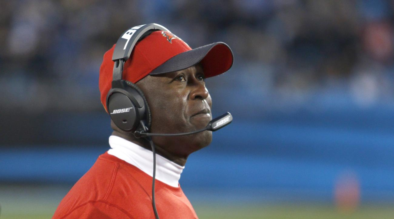 FILE - In this Jan. 3, 2016, file photo, Tampa Bay Buccaneers coach Lovie Smith watches his team take on the Carolina Panthers during an NFL football game in Charlotte, N.C. The Buccaneers fired Smith on Wednesday night, Jan. 6. Smith went 6-10 this year
