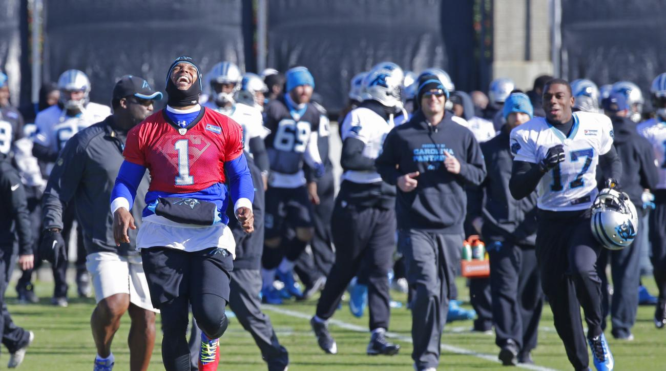Carolina Panthers' Cam Newton (1) laughs as he sprints to a drill during practice for the NFL football team in Charlotte, N.C., Thursday, Jan. 7, 2016. (AP Photo/Chuck Burton)